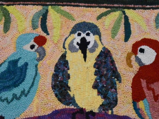 A tropical-themed rug sits finished inside the Naples