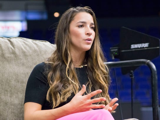 Olympic gymnast and activist Aly Raisman speaks at