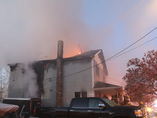 A fire destroyed two homes on Harmony Avenue in Middletown