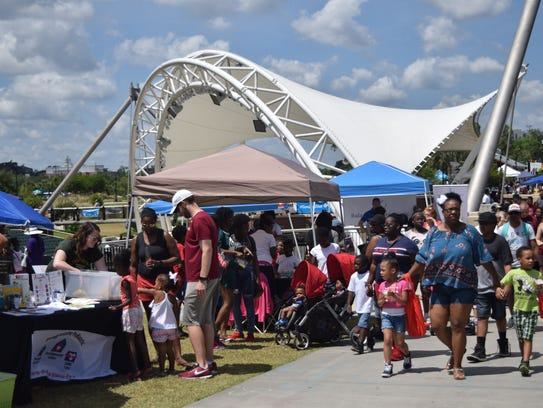 Kids play Saturday during Kidsfest at Cascades Park.
