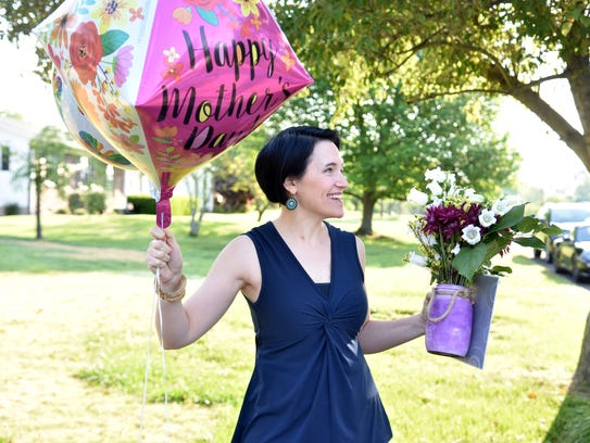 Marketing manager Heather Hebert gets ready to surprise
