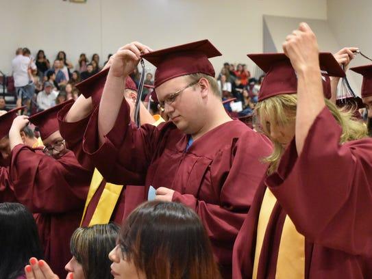 New Mexico State University-Alamogordo graduates flip