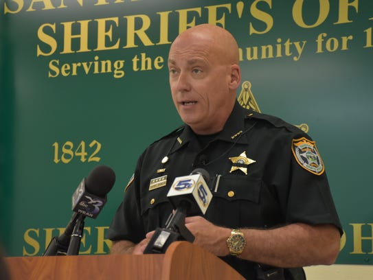 Santa Rosa County Sheriff Bob Johnson speaks at a press
