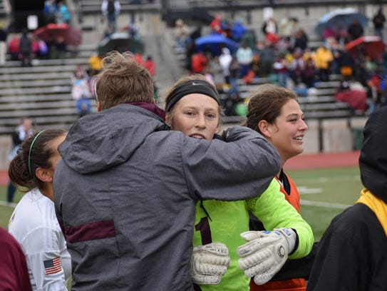 Windsor goalie Michaela Moran is congratulated after