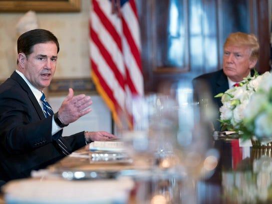 Arizona Gov. Doug Ducey, accompanied by President Donald