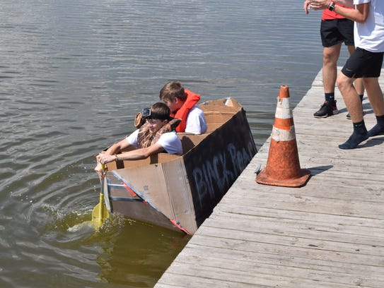 Principles of engineering students from Tioga High School built canoes made out of cardboard and duct tape. The canoes had to be seven feet long and three feet wide - enough to fit through a classroom door. Four teams consisting of four students each held a race at Lake Buhlow in Pineville on Tuesday to test their canoes' seaworthiness.