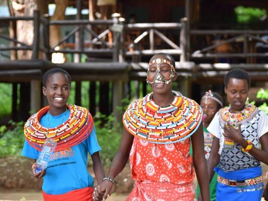 Samburu girls in northern Kenya dance after attending