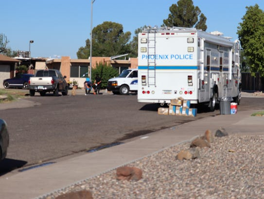 Phoenix police outside a home near 19th Avenue and