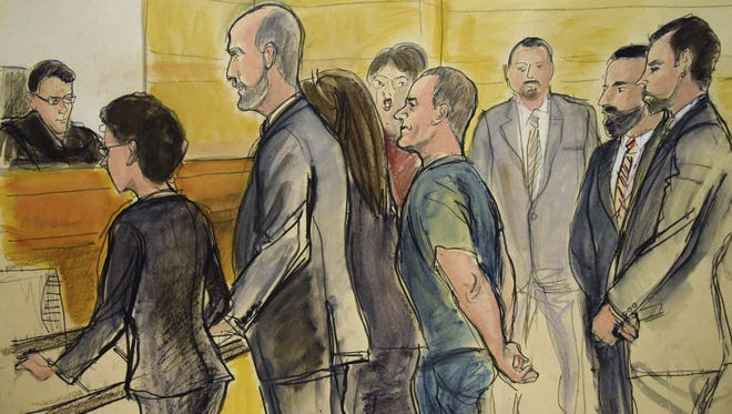 """In this courtroom drawing, Joaquin """"El Chapo"""" Guzman, center, appears in a New York courtroom on Friday, Jan. 20, 2017, after being extradited by Mexico to face federal drug trafficking and other charges. Guzman entered a not-guilty plea through his court-appointed lawyer and will be held without bail in a jail that has handled terror suspects and mobsters. From left are, Federal Judge James Orenstein; Assistant US Attorney Patricia Notopoulos; Federal Defender Michael Schneider, Federal Defender Michelle Gelernt, partially obscured; and the defendant. The three men at rear are Deputy U.S. Marshals."""