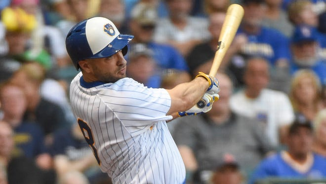 Brewers leftfielder Ryan Braun hits a single in the fourth inning.