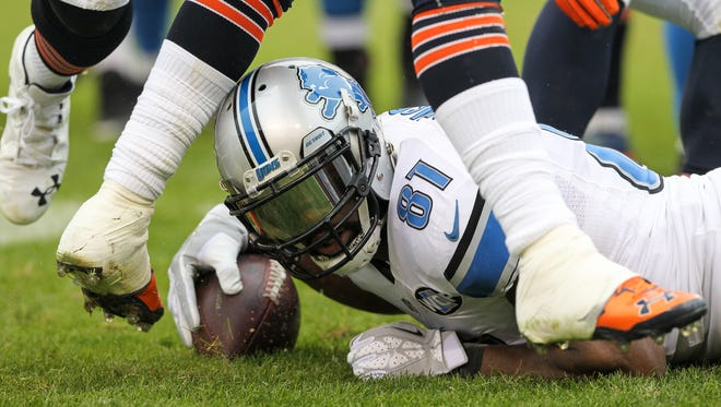 Calvin Johnson of the Detroit Lions looks up after being tackled by the Chicago Bears in the second quarter on Jan. 3, 2016, in Chicago.