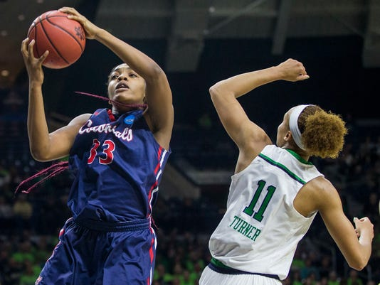 Robert Morris' Nneka Ezeigbo (33) grabs a rebound next to Notre Dame's Brianna Turner (11) during a first-round game in the women's NCAA college basketball tournament, Friday, March 17, 2017, in South Bend, Ind. (AP Photo/Robert Franklin)