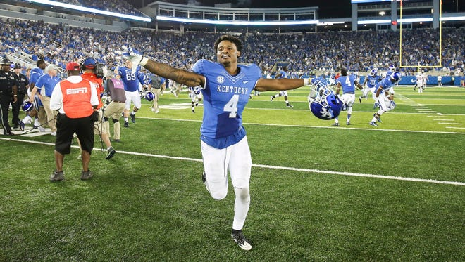 Kentucky running back Mikel Horton celebrates as he runs off the field after he scored the winning touchdown over Louisiana-Lafayette in an NCAA college football game in Lexington, Ky., Saturday, Sept. 5, 2015.