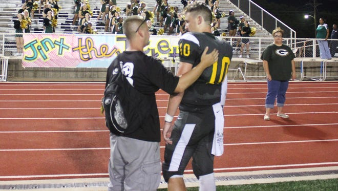 Captain Shreve quarterback Lucas Grubb (right) was injured during the Gators' jamboree with Byrd.