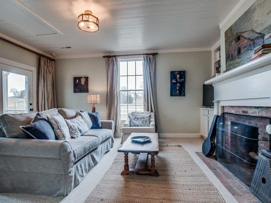 The 1900s cottage has all original wood floors, fireplaces, walls and trim.
