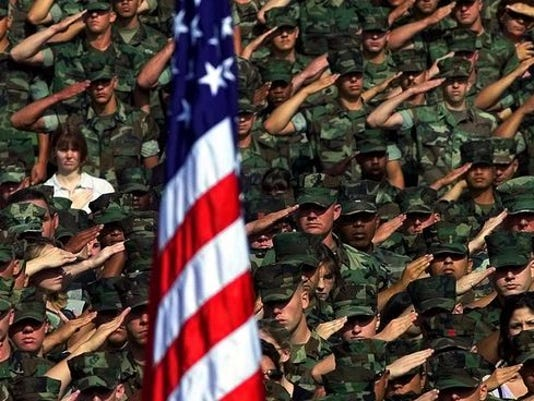 Marines saluting American flag
