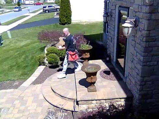New Castle County police say the man seen in this surveillance video stole two package from a home in the 200 block Marjoram Dr. Monday afternoon.