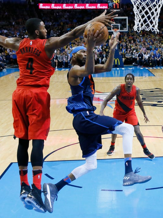 Oklahoma City Thunder forward Corey Brewer (3) goes to the basket defended by Portland Trail Blazers forward Maurice Harkless (4) in the second half of an NBA basketball game in Oklahoma City, Sunday, March 25, 2018. (AP Photo/Sue Ogrocki)
