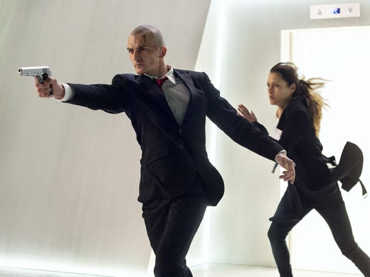 """Rupert Friend, left, and Hannah Ware star in """"Hitman: Agent 47."""""""