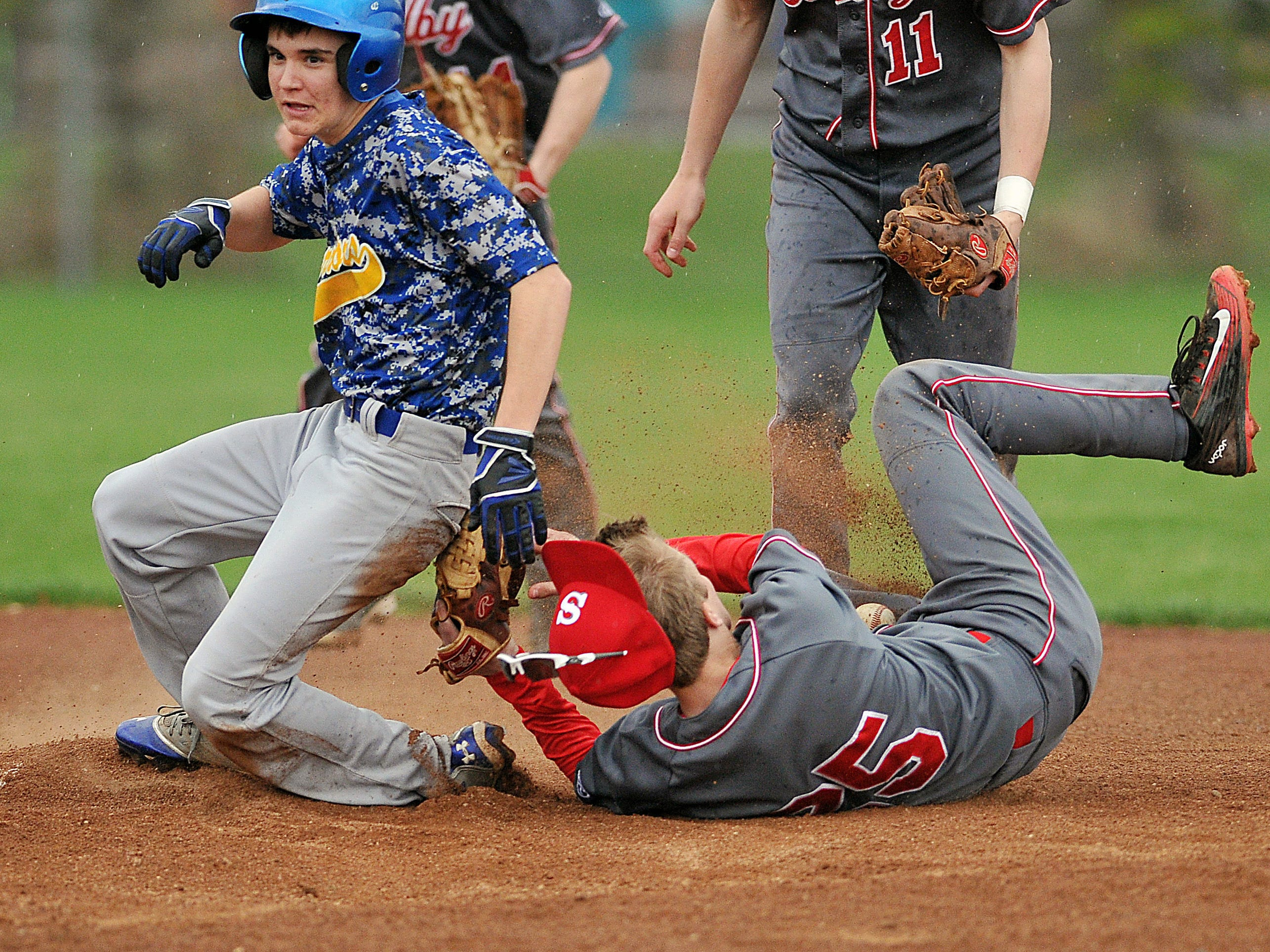 Players get tangled up at second base during a game Monday between Shelby and Ontario.