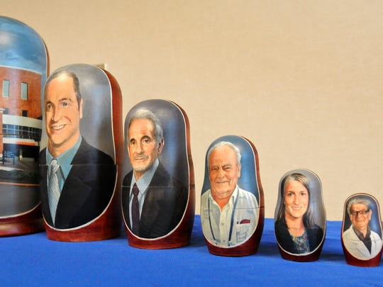 Matryoshka stacking dolls depict the doctors who performed the transcatheter aortic valve replacement procedure on Clarence Enneking. The matryoshka set was presented during a ceremony at the hospital July 24.