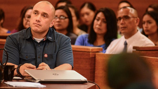 Former Guam Police Officer and defendant Mark Torre Jr., listens to the opening statements from a prosecutor during the first day of his trial at the Superior Court of Guam on Monday, Jan. 30, 2017. Torre is facing charges in connection to the shooting death of fellow officer Sgt. Elbert Piolo, outside his family's home in Yigo in July 2015.