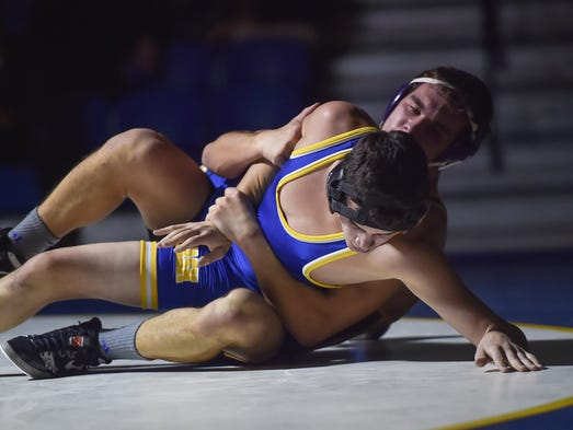 Waynesboro's Quinten Harris is trying pin Travis Wickard
