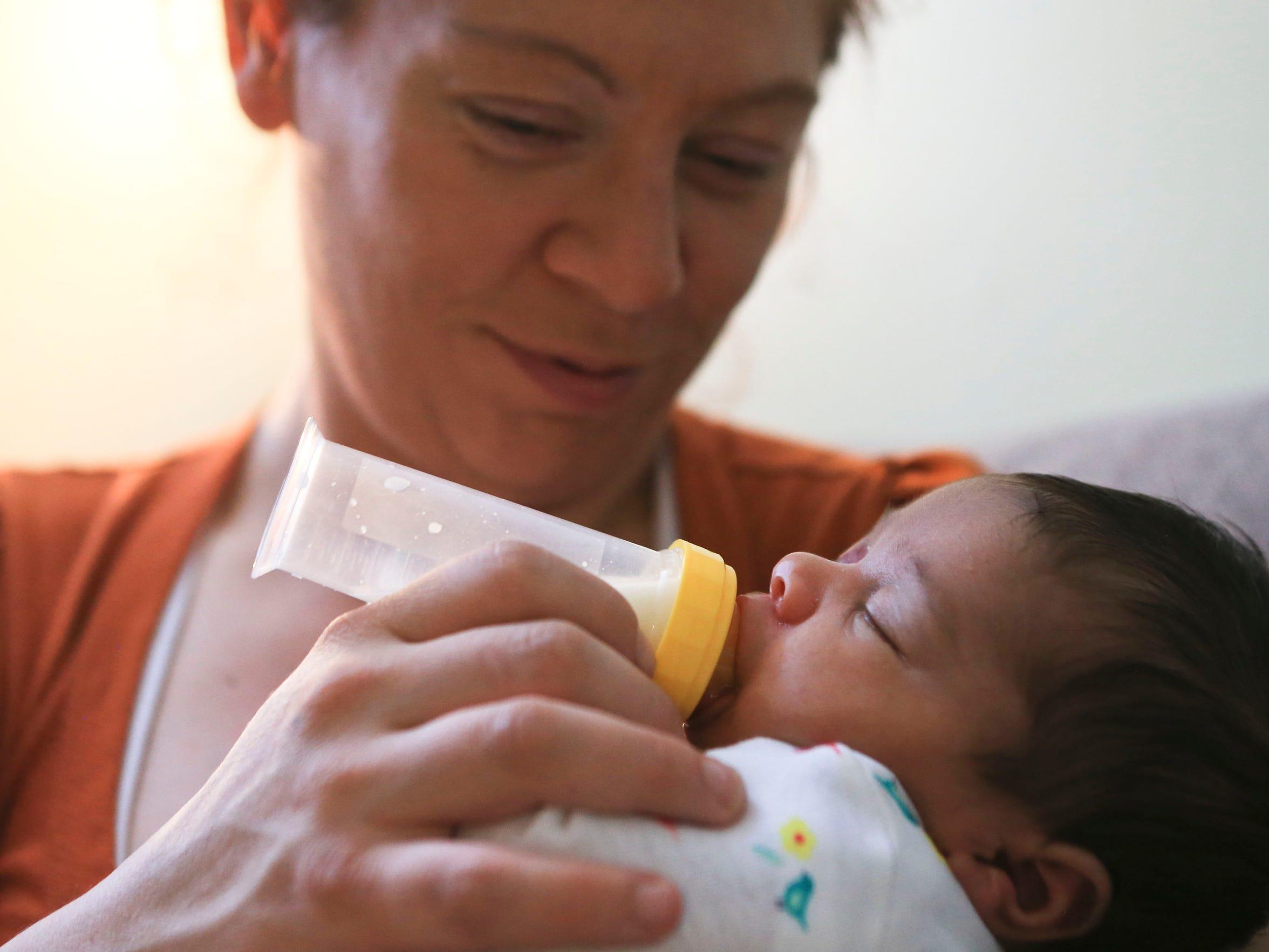 Kymbal Pruett, 36, tends to newborn Elisabeth while