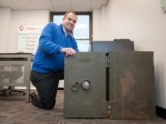 TetherView, a turnkey private cloud provider, recently started operating out of the old Russel Hall building at the closed Fort Monmouth in Oceanport. Michael Abboud, CEO, is pictured in his office which sports a safe left behind when the Army left Fort Monmouth.
