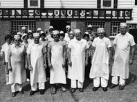 Widmer Cheese employees step outside for a picture in front of the cheese factory in 1979. Jim Widmer (far right) is pictured with his nephew Joe Widmer (center) current owner, and brothers John Widmer (third from right) and Ralph Widmer (second from right).