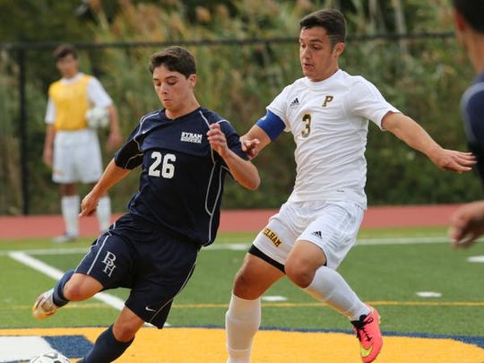 Byram Hills' Ryan Blum and Pelham's Octavio Basso fight for possession during their boy's varsity soccer game Sept. 30, 2014 at Grover field.