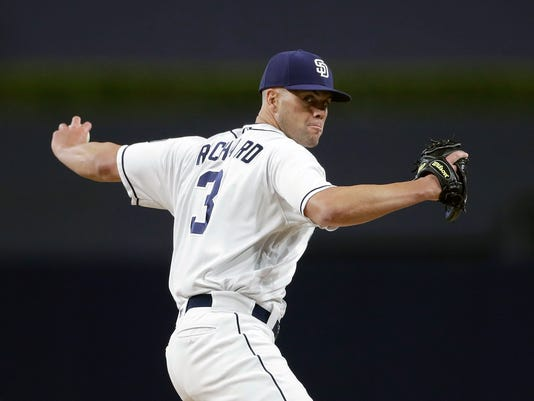 FILE - In this Sept. 21, 2017, file photo, San Diego Padres starting pitcher Clayton Richard works against a Colorado Rockies batter during the first inning of a baseball game in San Diego. Richard is scheduled to start opening day, anchoring a rotation that includes Mitchell (26), Dinelson Lamet (25), Luis Perdomo (24) and Tyson Ross (30). Richard, the oldest player on the squad, signed a two-year contract extension through 2019 but isn't guaranteed to keep his spot in the rotation. (AP Photo/Gregory Bull, File)