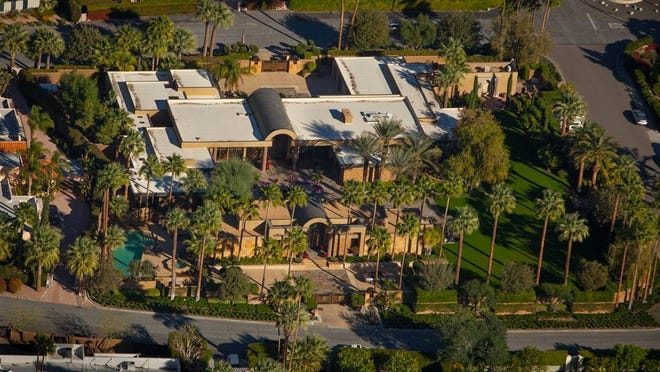 Jim Houson's Palm Springs home, seen in this aerial photo, is up for sale for $11 million.