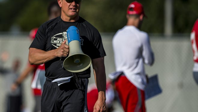 UL head coach Mark Hudspeth shouts out commands during a UL fall football camp session in Lafayette, Friday, Aug. 7, 2015.