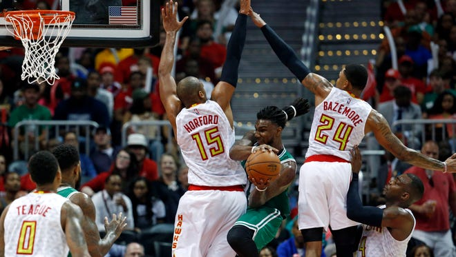 Boston Celtics forward Jae Crowder (99) attempts a pass out of the defense of Atlanta Hawks center Al Horford (15) and forward Kent Bazemore (24) in the second game of their first round playoff series.