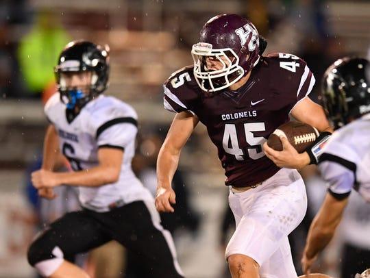 Henderson County's Ian Pitt picks up good yards on