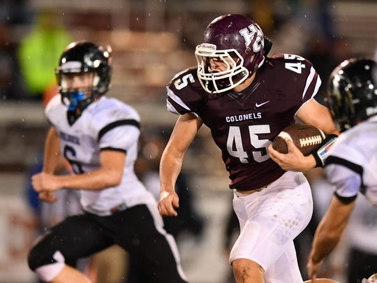 Henderson County's Ian Pitt picks up good yards on