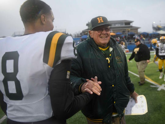Farmington Harrison coach John Herrington congratulates