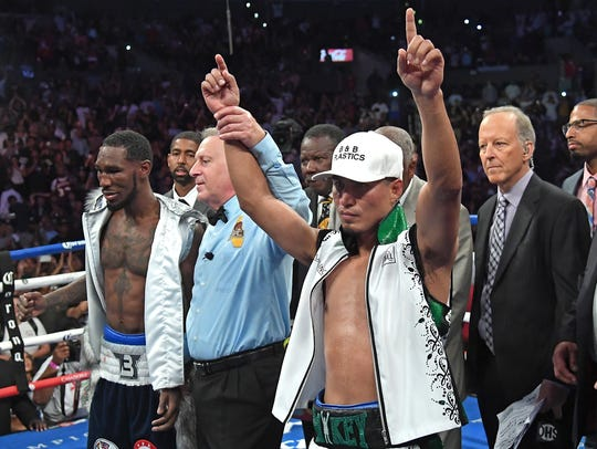 Mikey Garcia celebrates a unanimous decision over Robert Easter Jr.