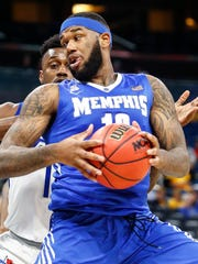 Memphis forward Mike Parks drives the lane against Tulsa last season. Parks will miss the Tigers' first exhibition game.