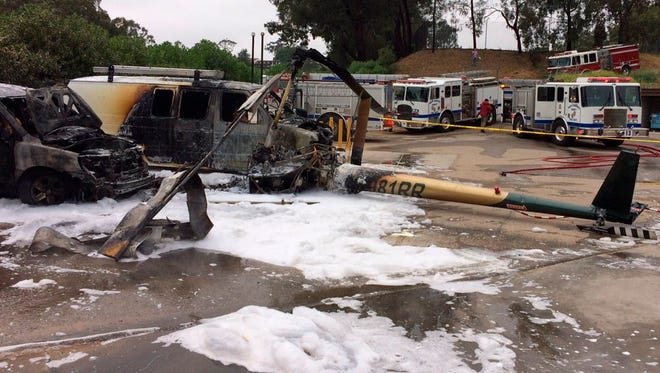 A Robinson R-44 helicopter returning from a tourist flight crashed and burned, injuring people on board, at La Cumbre Country Club on Friday in Santa Barbara, Calif. The aircraft hit two vans, but nobody on the ground was hurt.