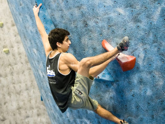 """Climber Zach Levy competes in a bouldering competition at Focus Climbing Center in Mesa. Focus owner Joe Czerwinski encourages even new climbers to enter comps. """"I try to get people out of the mindset that they can't compete just because they're new,"""" he said. """"It's not about winning; it's about getting out there and trying it."""""""