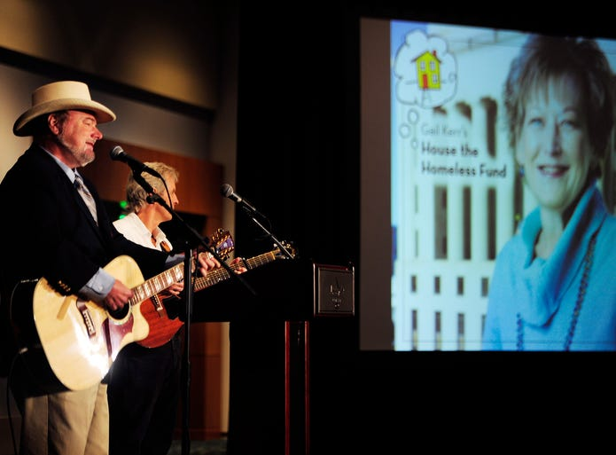 """Les Kerr performs his song """"The Gail"""" during a luncheon Tuesday, July 8, 2014, at the Music City Center.  Kerr and The Tennessean recognized donors and unveiled the amount of money raised to house the homeless in honor of Gail Kerr, a longtime Tennessean columnist who died March 25 at 52."""