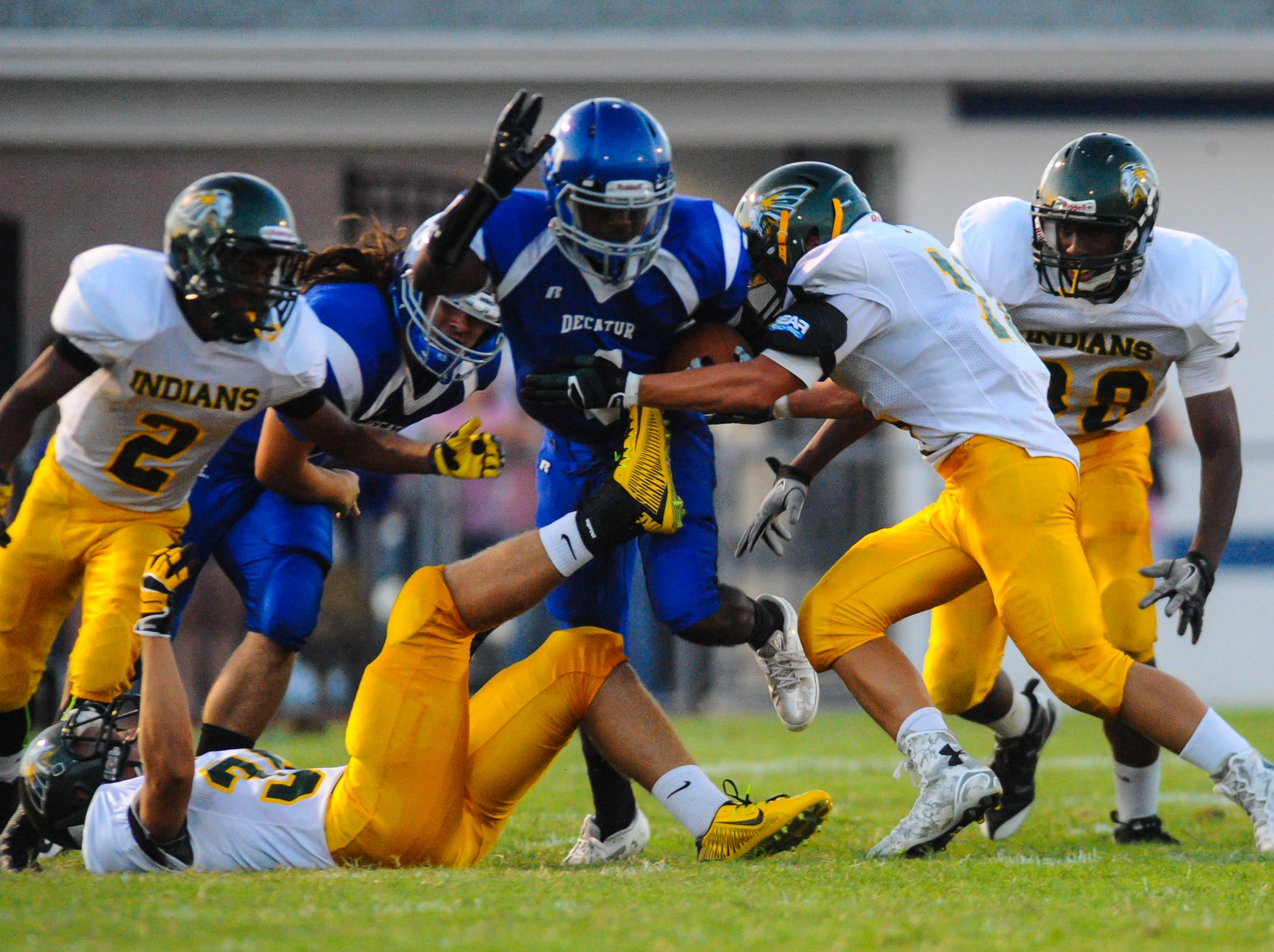 Stephen Decatur running back Dontae Baines eludes tackles by Indian River defenders on Friday night in Berlin.