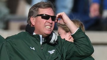 A person familiar with the search says Florida has hired Colorado State's Jim McElwain as its next football coach.