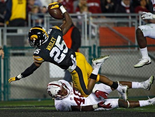 Iowa running back Akrum Wadley scores against Stanford during the second half of the Rose Bowl NCAA college football game, Friday, Jan. 1, 2016, in Pasadena, Calif. (AP Photo/Lenny Ignelzi)