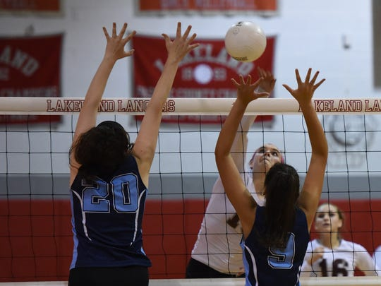 Clifton # 15 Alison Moran spikes the ball Passaic County tournament semifinals, at Lakeland, Wayne Valley (blue) and Clifton (white)