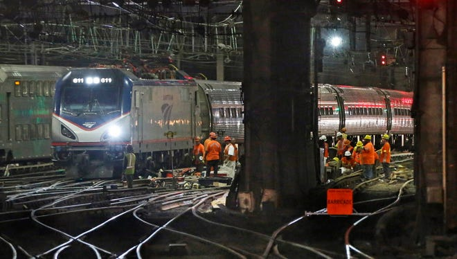 Amtrak workers continue ongoing infrastructure renewal work July 9, 2017, beneath Penn Station in New York.
