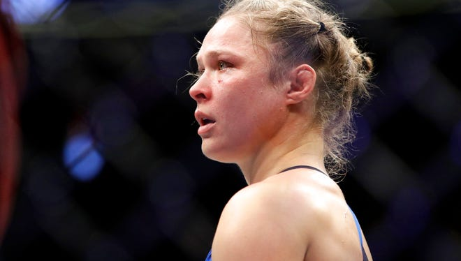 In this Dec. 30, 2016, file photo Ronda Rousey stands in the cage after Amanda Nunes forced a stoppage in the first round of their mixed martial arts bout at UFC 207 in Las Vegas. Rousey's next fight could come in a WWE ring.