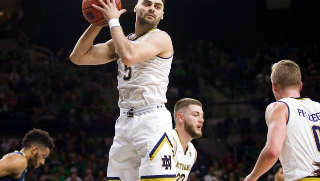 Notre Dame's Matt Farrell (5) grabs a rebound during the first half of an NCAA college basketball game against Pittsburgh Wednesday, Feb. 28, 2018, in South Bend, Ind. Notre Dame won 73-56. (AP Photo/Robert Franklin)
